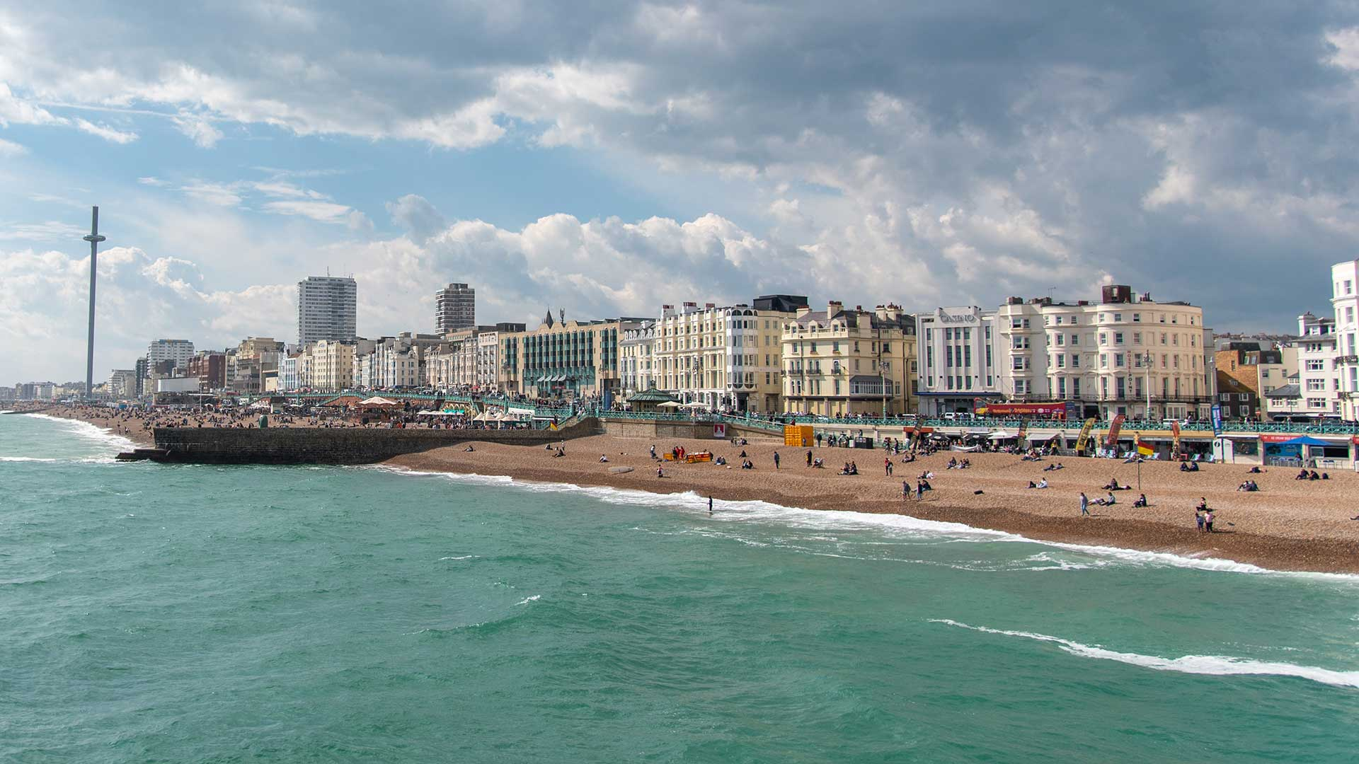 Brighton beach ib the sunshine, looking out past the i360