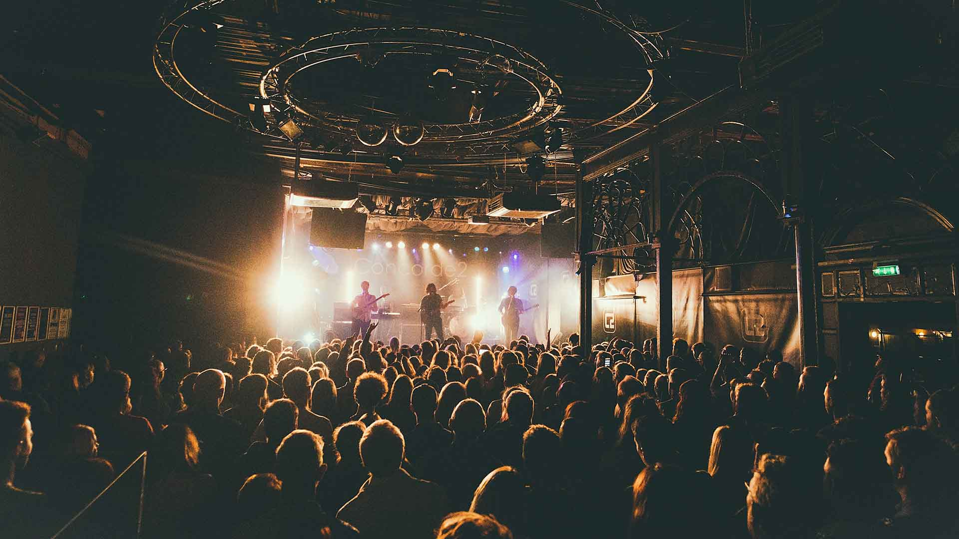 Brighton's music venue Concorde 2 with a band on stage surrounded by fans