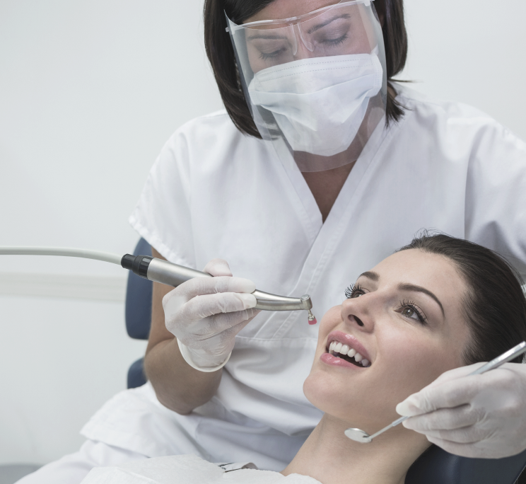 A dentist looking in a patients mouth