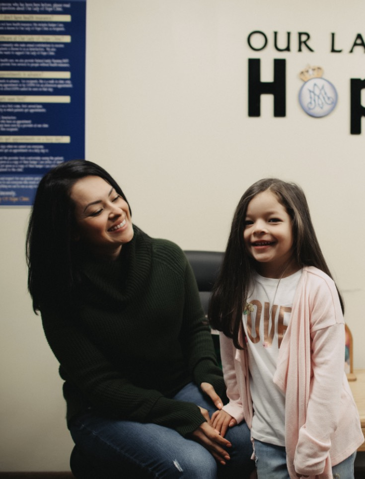Photo of a mom and daughter in our clinic waiting area