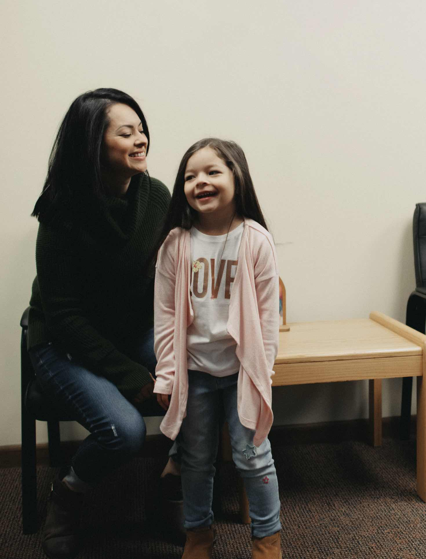 Photo of a mom and daughter in our lobby