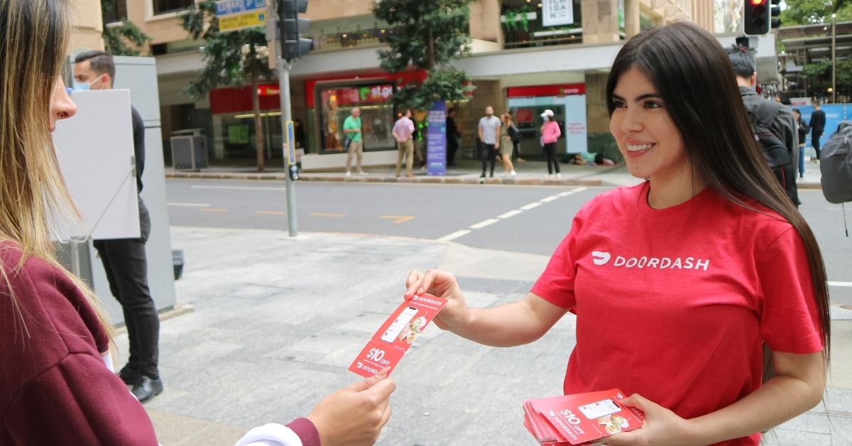 Brand ambassador distributing leaflets happily