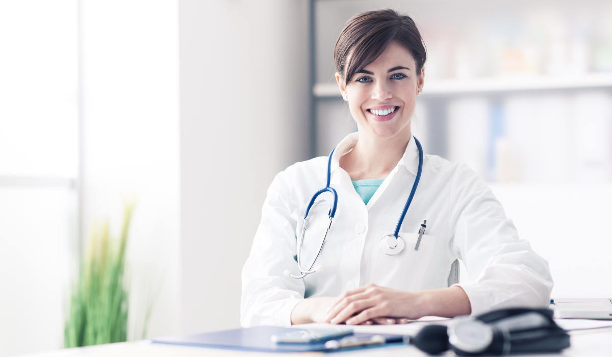 Female doctor in lab coat and stethoscope.