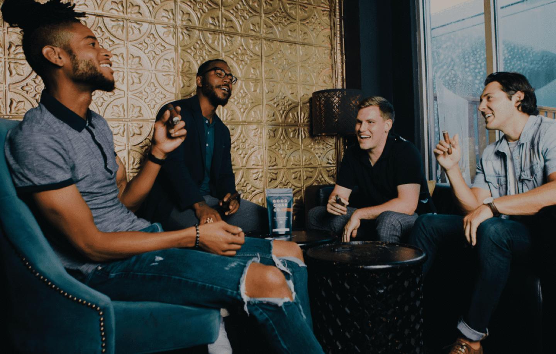 A group of men smoke cigars at Good Cigar Co.