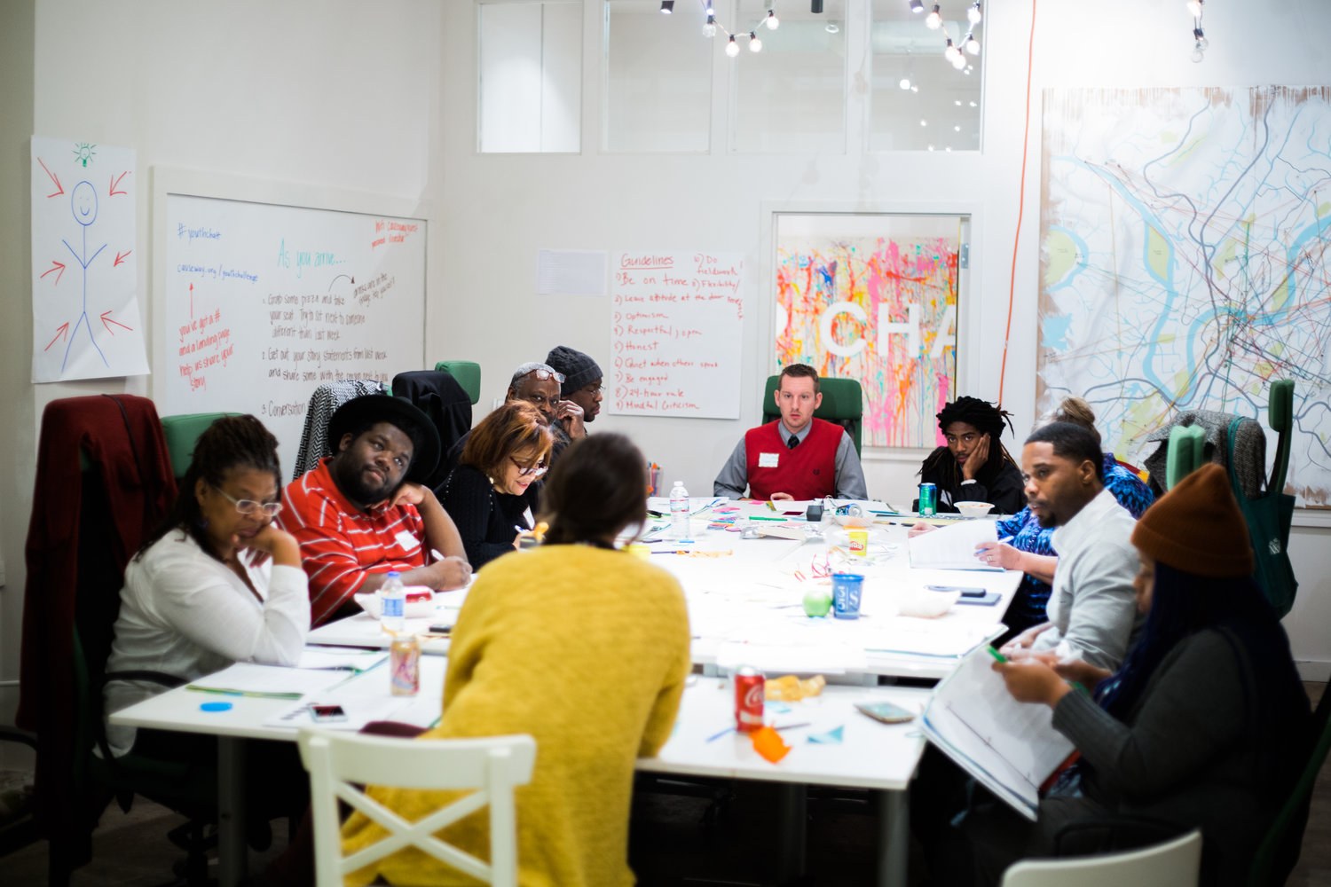 Wide shot of a group of Causeway participants gathered at a conference table.