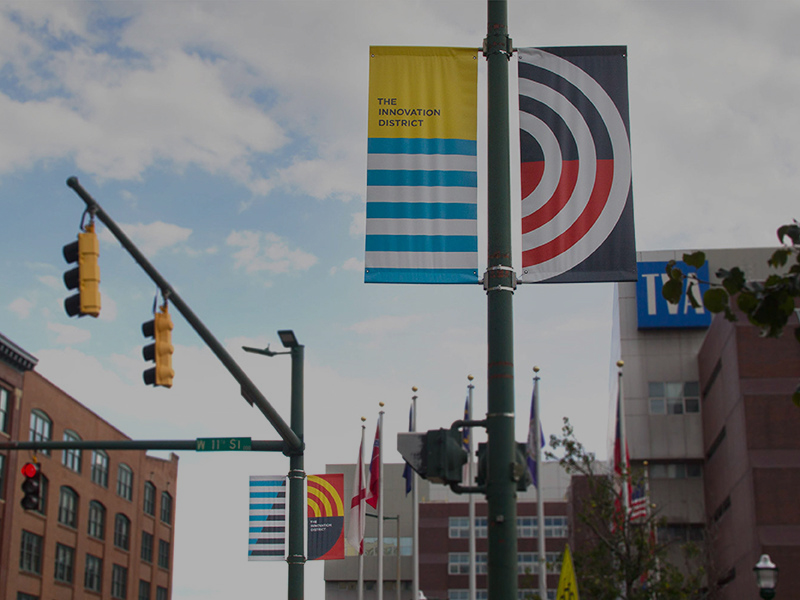 Flagpole showing the Innovation District logo.
