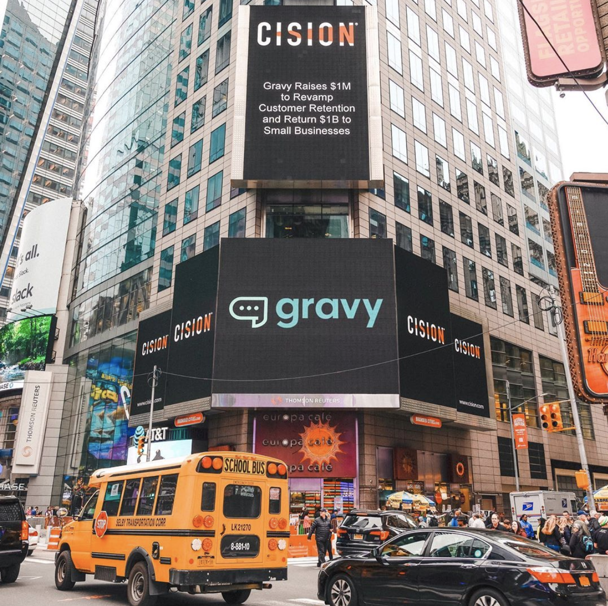 A NYC billboard displays the Gravy logo.