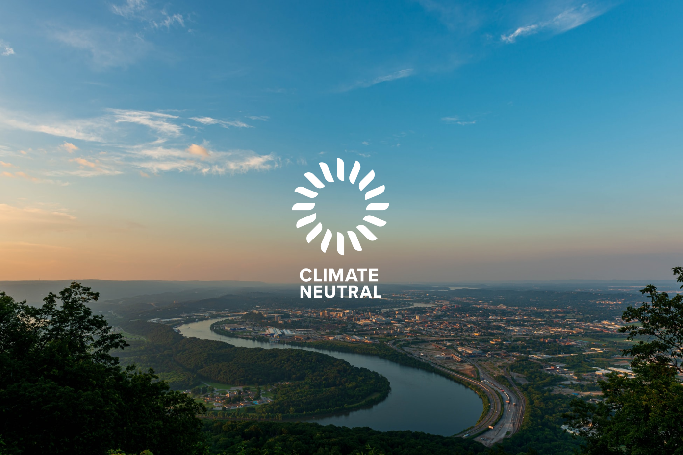 Panoramic aerial of Chattanooga with the Climate Neutral logo.