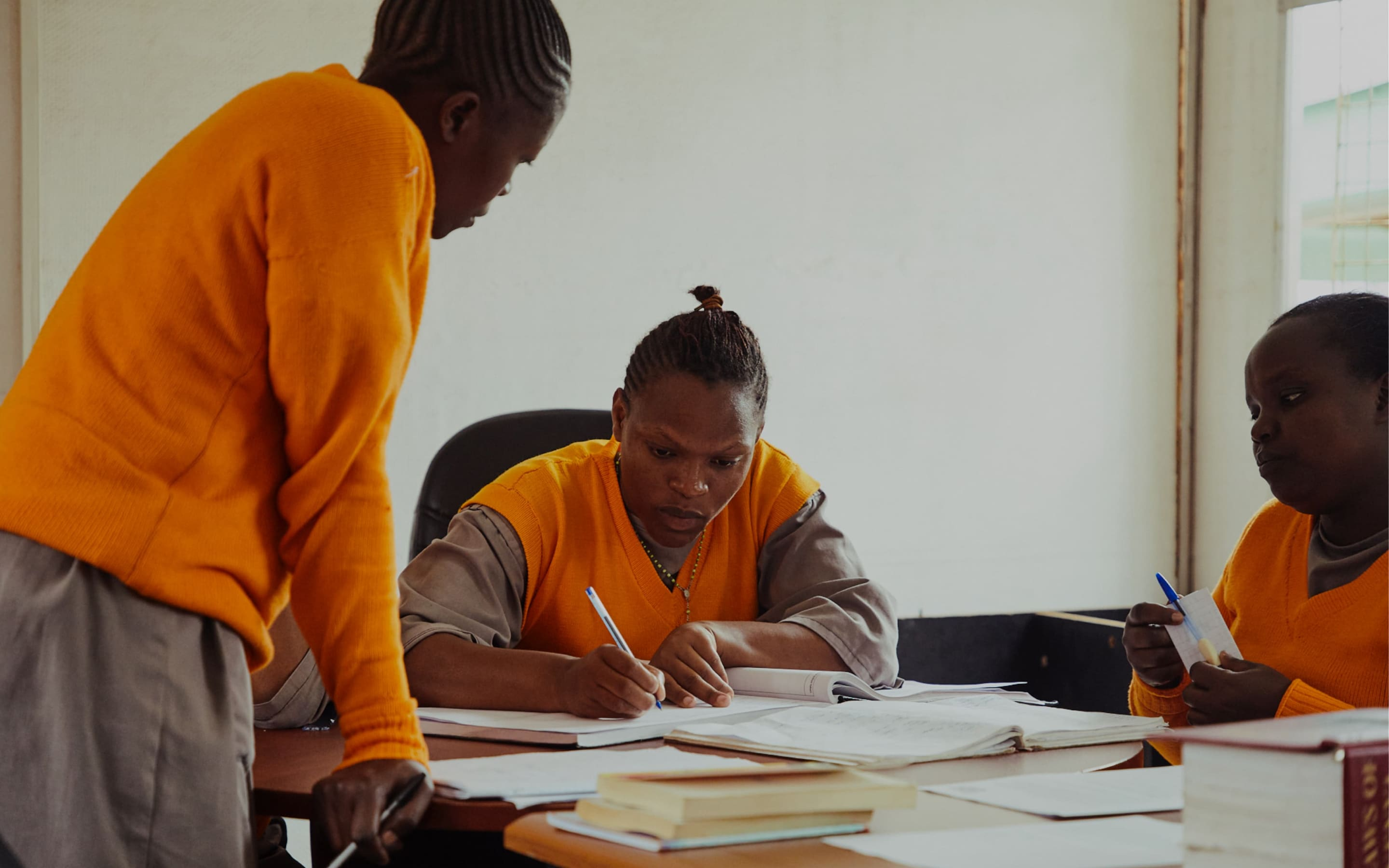 Justice Defenders participants study in a library.
