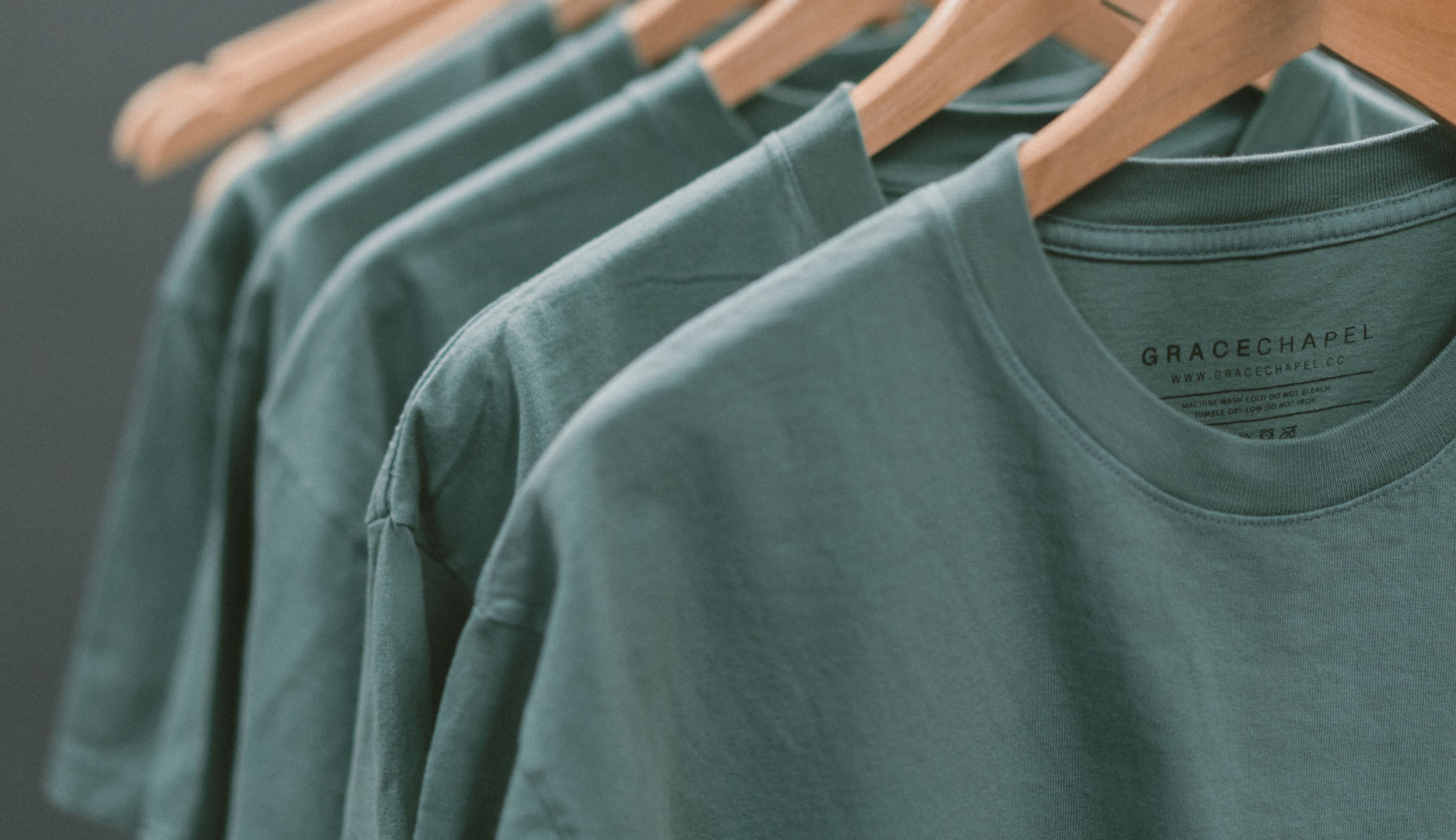 Close-up image of a rack of t-shirts.