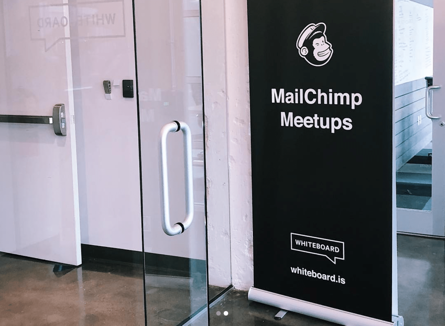 "Photo of a standup flag that reads ""Mailchimp Meetups"""