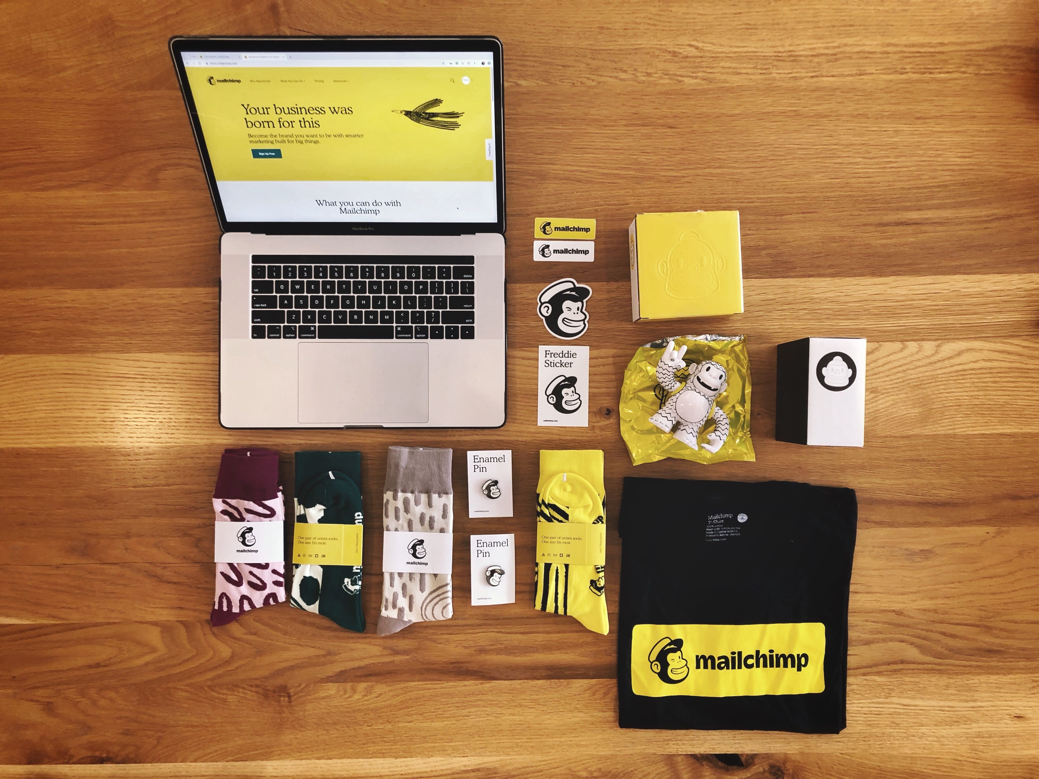 Flat lay of an assortment of Mailchimp swag.