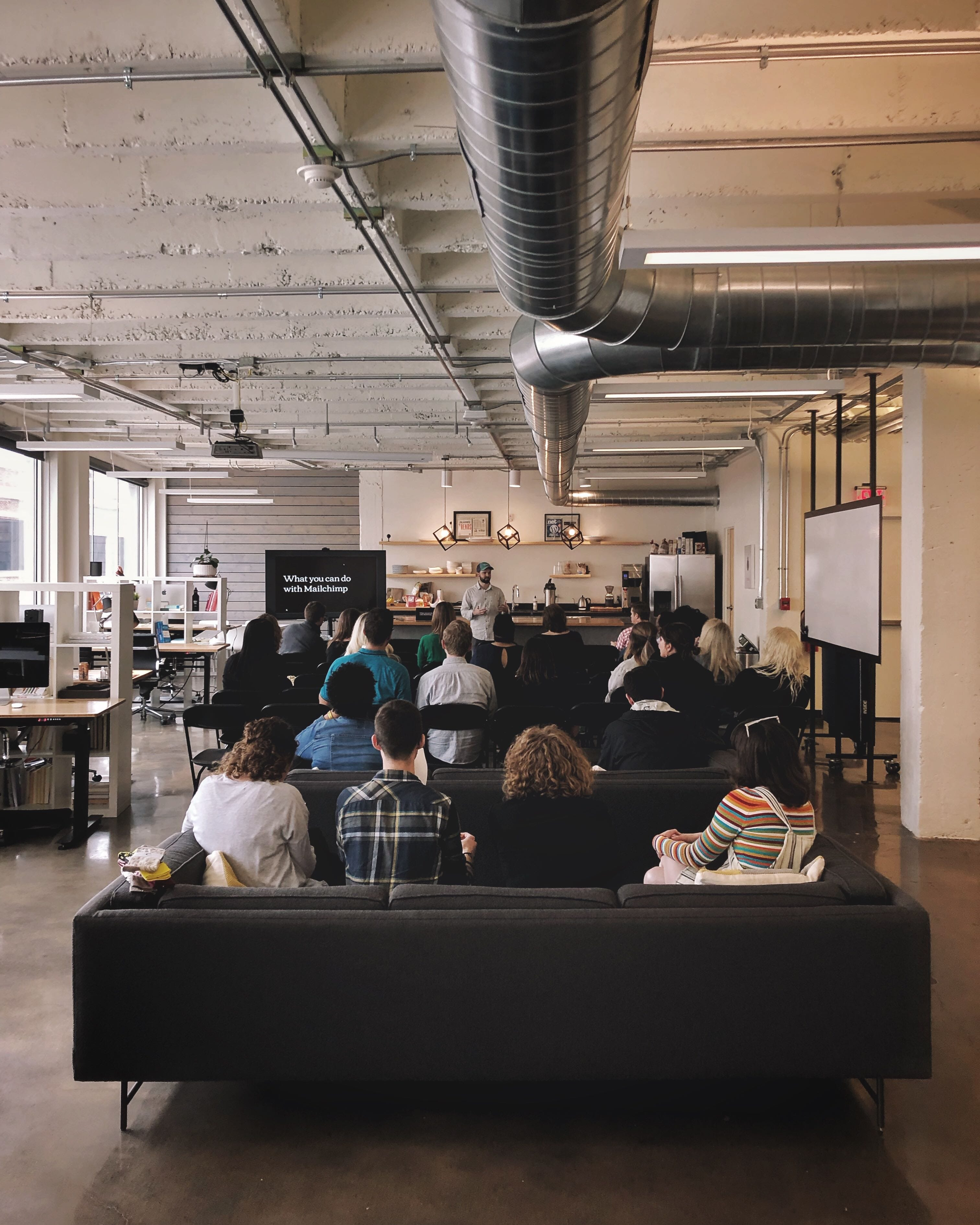 Nick Blackmon, director of Marketing, leads a Mailchimp gathering at the Whiteboard office.