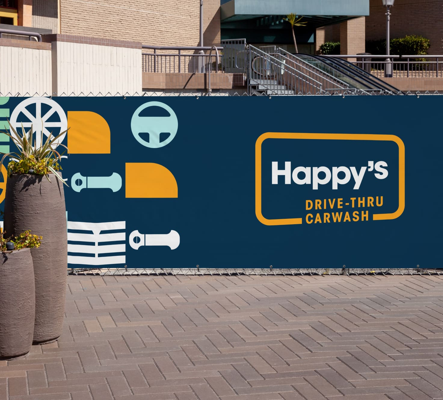 A mockup showing the Happy's Car Wash on a wall decal.