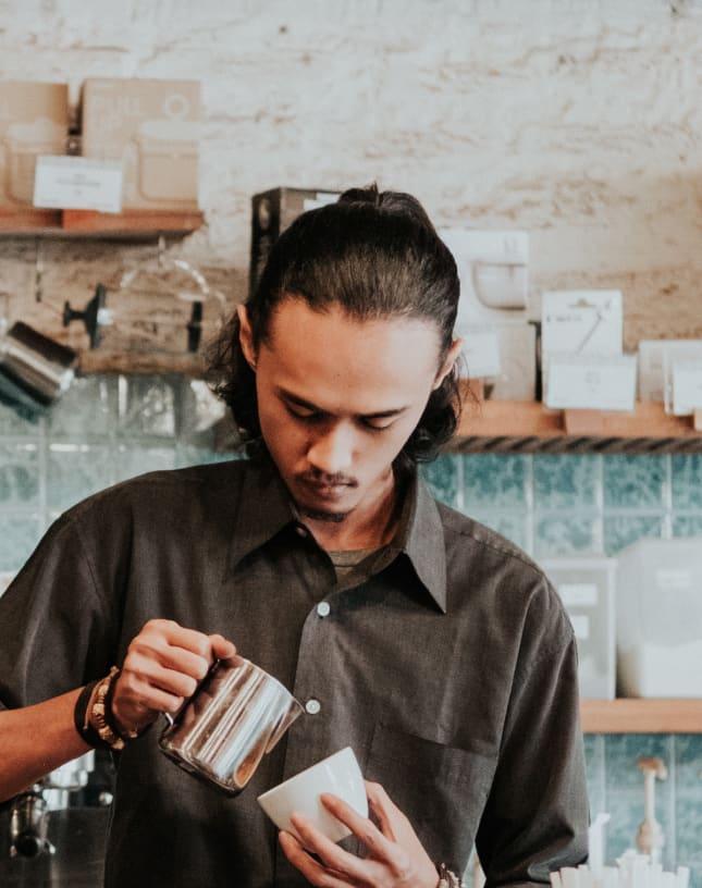 A barista prepares coffee.