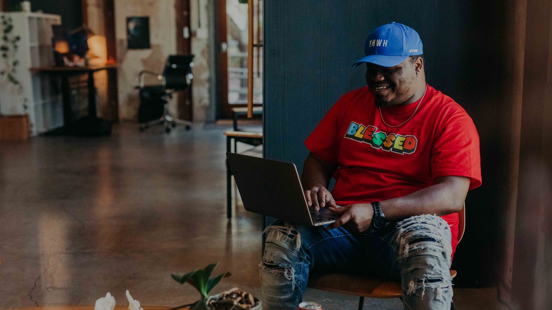 Whiteboard employee Dennis Rivers works on a laptop.