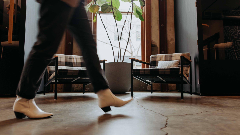 A Whiteboard employee walks across the office.