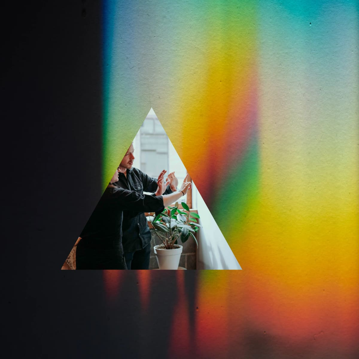 Collage image of a prism with two Whiteboard employees brainstorming in front of a whiteboard.