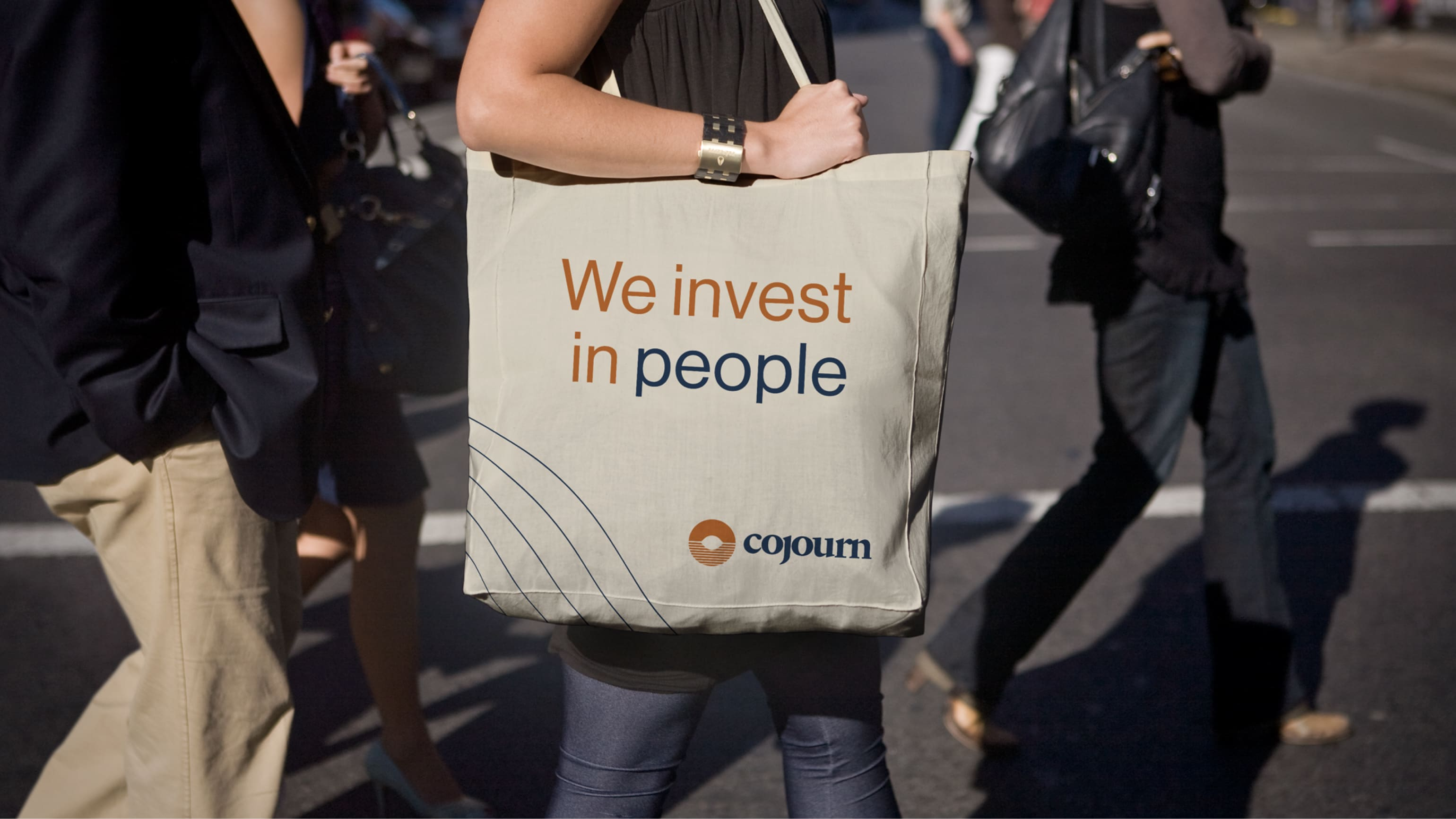 Mockup showing the Cojourn logo on a tote bag.