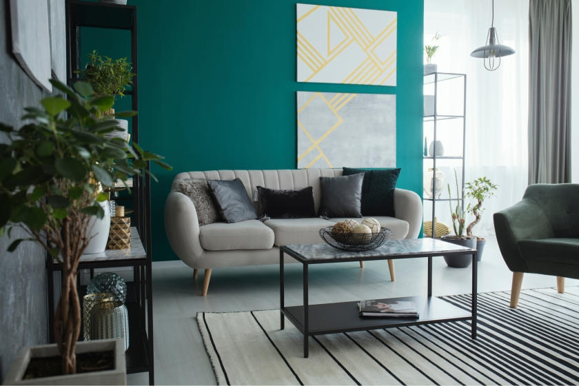 Green living room with yellow accents