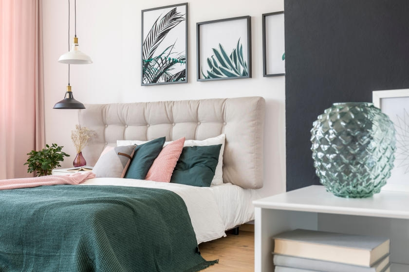 Blue and white bedroom with green and pink decor