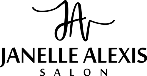 The Janelle Alexis Salon company logo featured on a mock-up of a laptop.