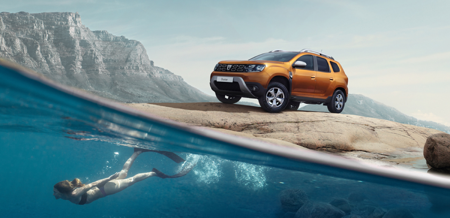 Dacia Duster next to lake, woman diving in the lake