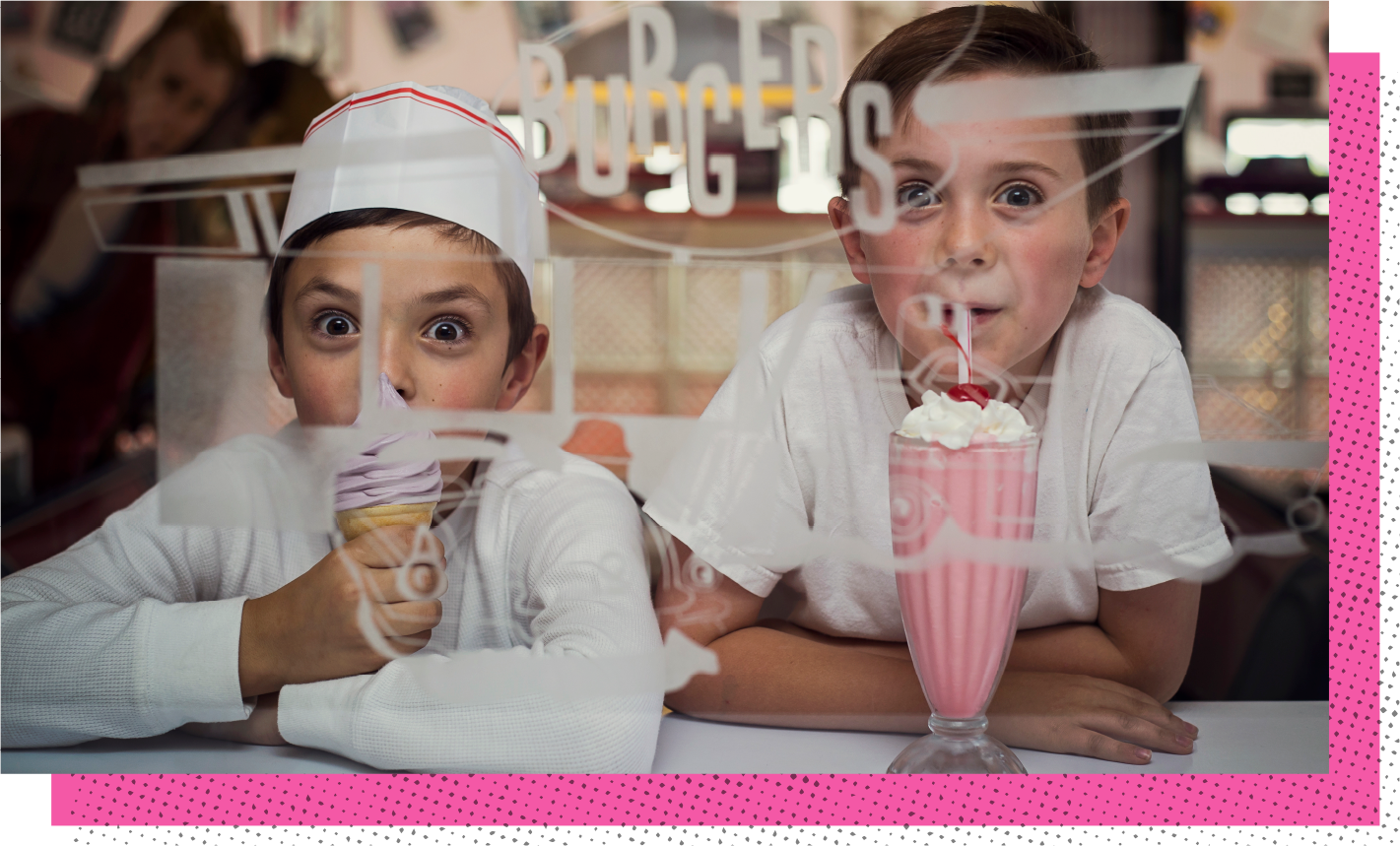 2 boys eating ice cream and a milkshake