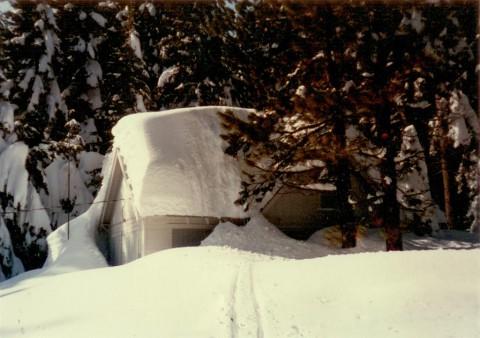 Cabin under heavy snow