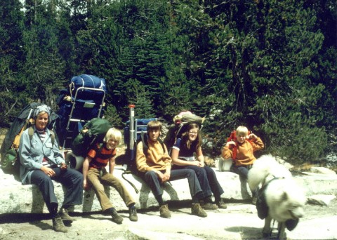 Family backpacking from the mountain cabin