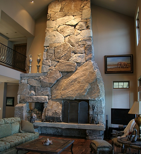 A Precast Masonry Rumford Style Fireplace by Pacific Construction.