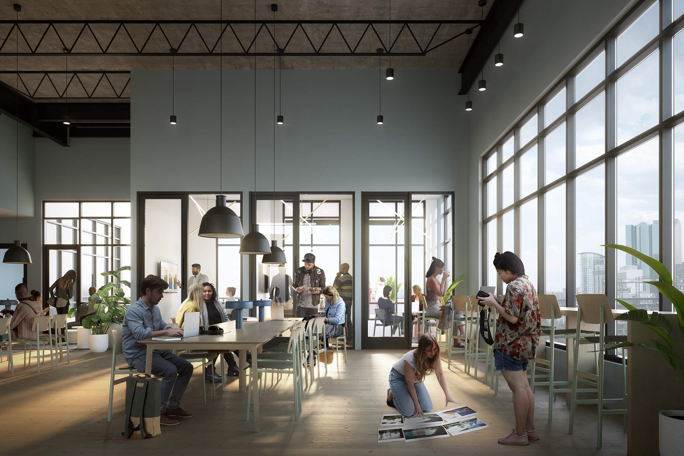 X Denver coworking space with people working at community desks and in offices