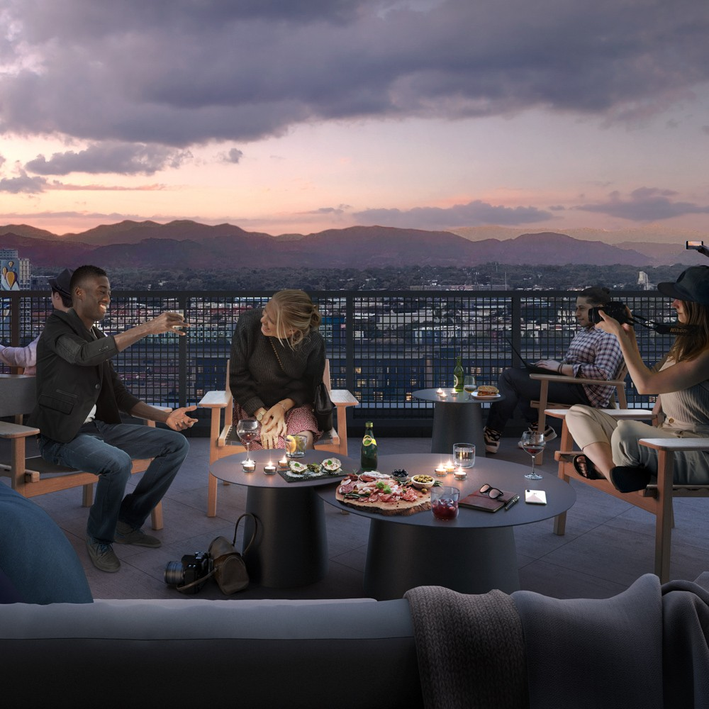 X Club outdoor terrace with people enjoying dinner and drinks with mountain view in the background