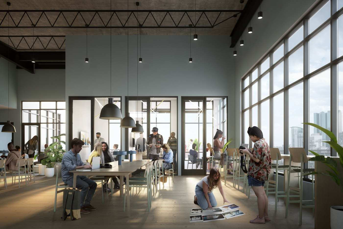 Interior view of X Denver coworking space, with residents using community desks and private offices