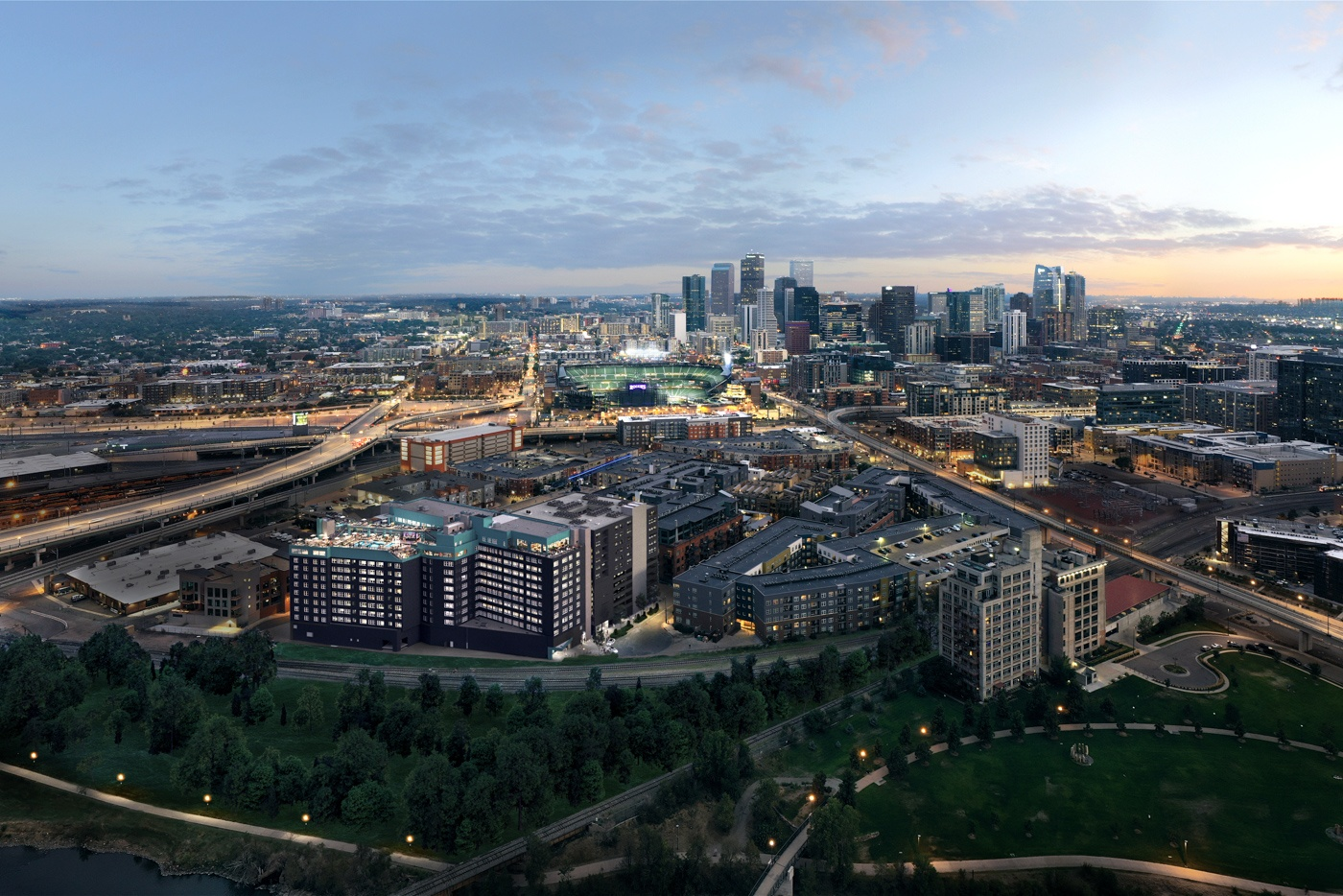 Aerial view of X Denver with Coors Field and downtown Denver in the background