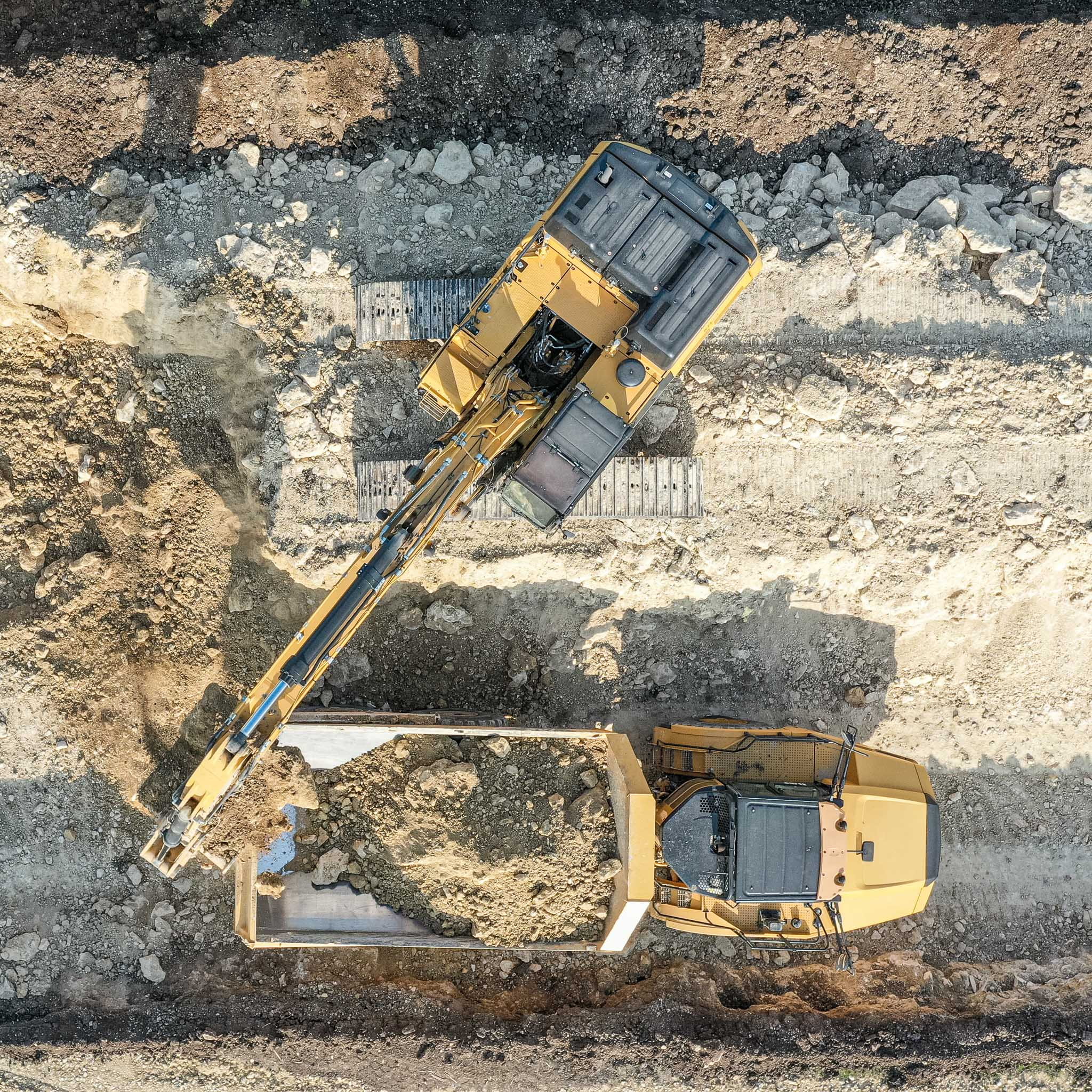 Aerial view of excavator and haul truck