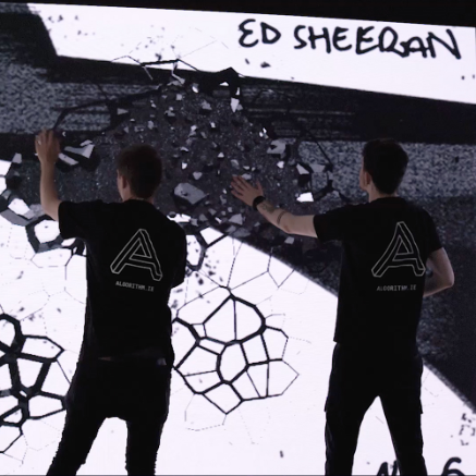 The Algorithm team using the interactive screen at the Ed Sheeran Launch