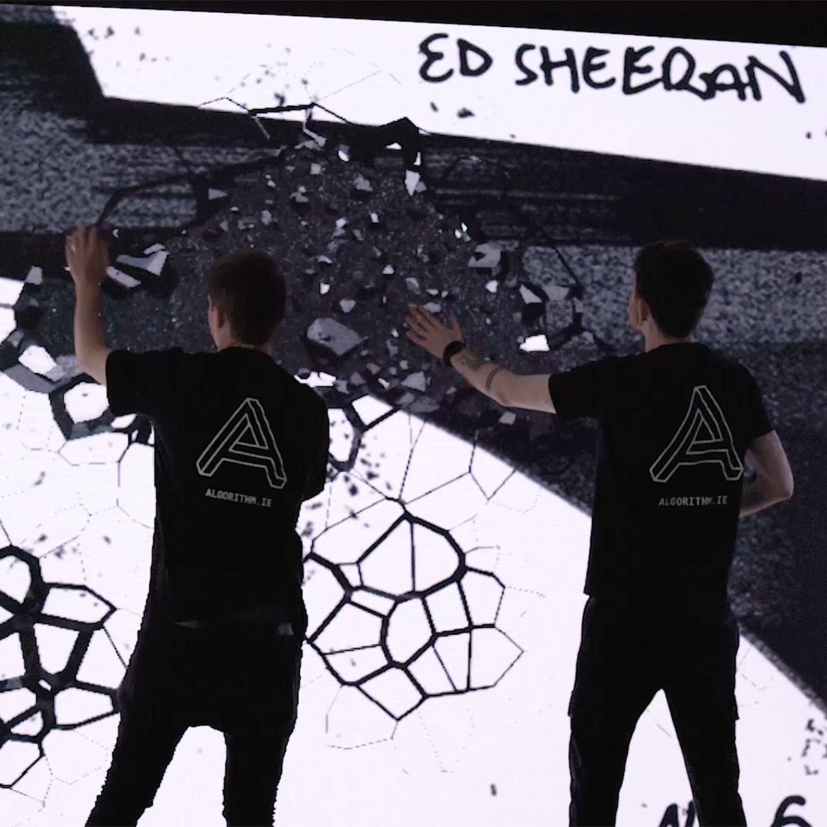 The Algorithm team using the interactive Ed Sheeran wall