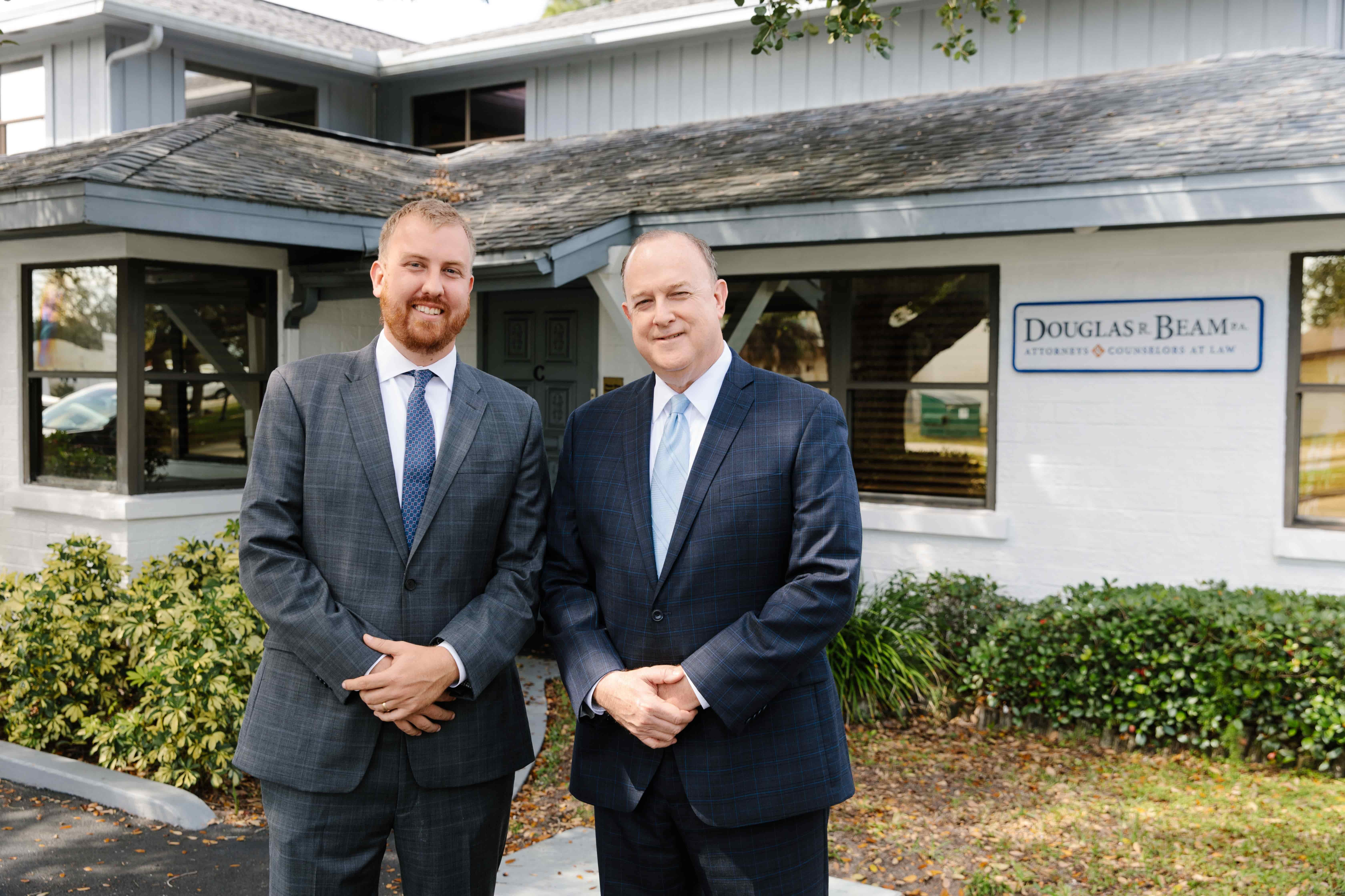 Attorneys Doug and Riley Beam stand outside of their law office in Melbourne, Florida.