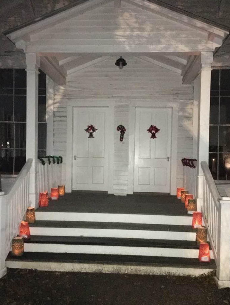 Luminarias on the porch of Seguin's First Church.