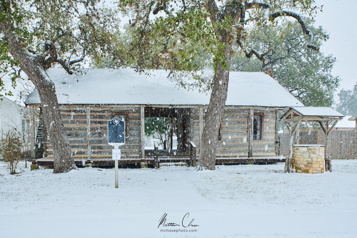 A wintry image of the Campbell-Hoerman Log Cabin.