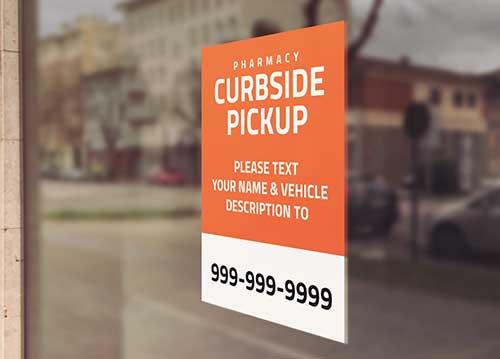 Image of orange curbside pickup sign