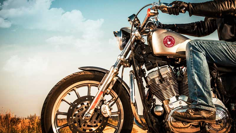 Image of motorcycle with landscape in the background