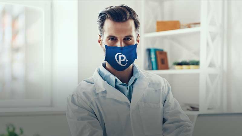 Image of pharmacist wearing blue face mask