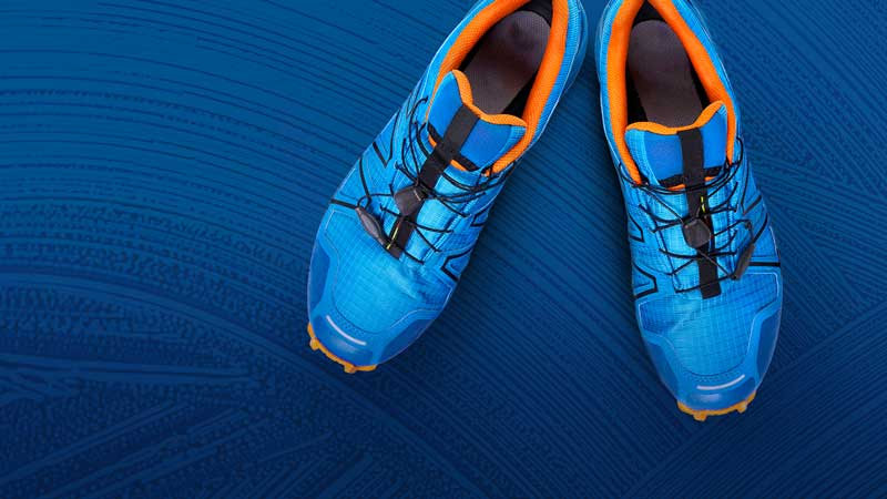 Image of soccer shoes and blue gradient overlay in background