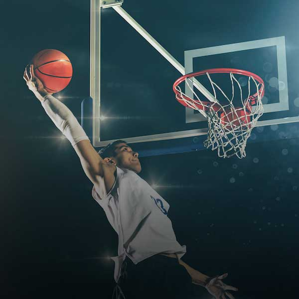 Image of basketball player dunking a ball