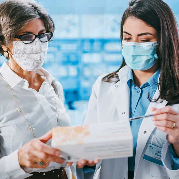 Image of pharmacist and patient working together