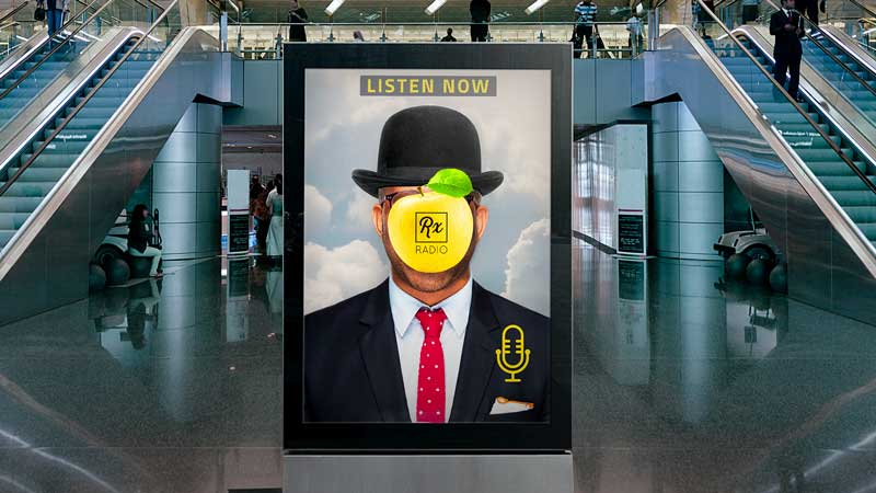 Image of man in an advertisement in the middle of an airport