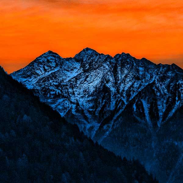 Image of mountains with orange background