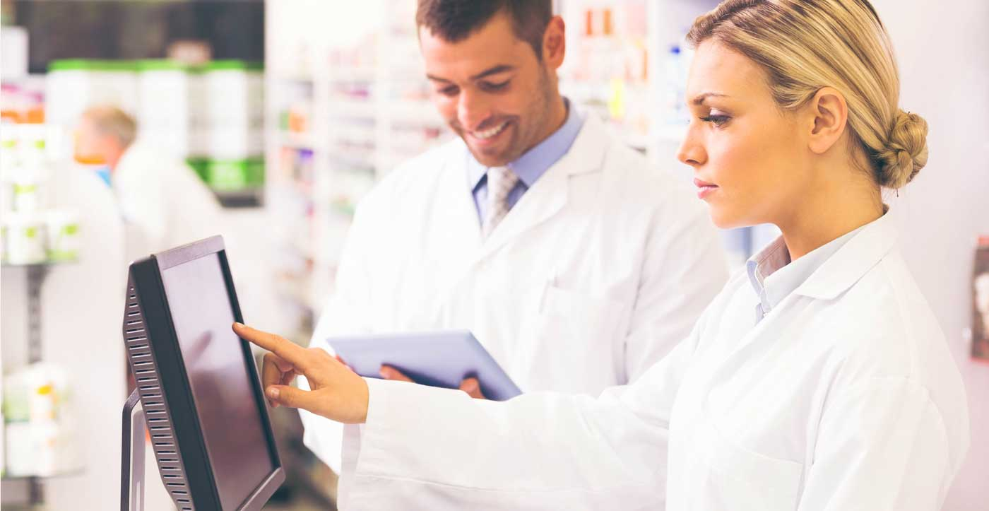 Image of pharmacist working on computer